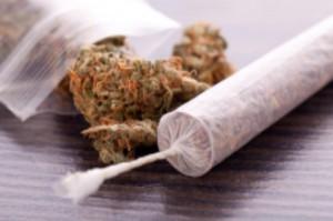 Marijuana joint on table with bag of cannabis: WeedWired Marijuana Legalization Blog