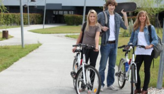 Students outdoors riding bikes and skateboarding: WeedWired Industry News Blog